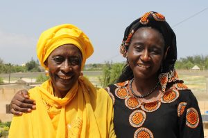 Portait of human rights defender Fatimata Sy with a community member in Thies, Senegal.