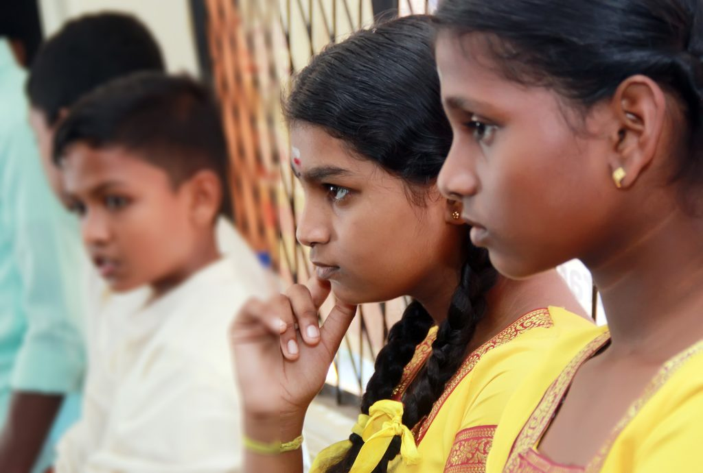 A young girl takes part in Play it Fair! activities with other youth from different religions in Sri Lanka.