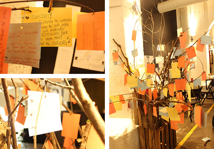 Tree branches with dozens of postcards activity at the Equitas youth engagement event in Montreal