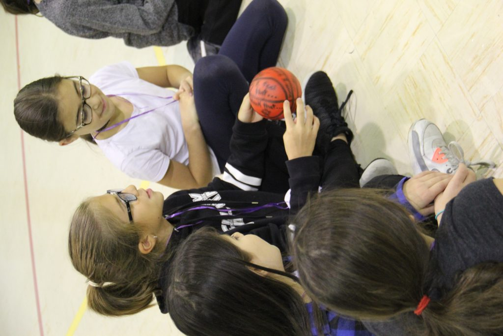 Children at the English Montreal School Board playing Equitas Play it Fair activities in a gymnasium